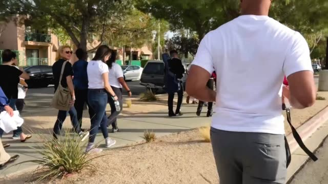 voters march toward a polling place to participate in early voting in california's 25th congressional district on november 4, 2018 in lancaster,... - midterm election stock videos & royalty-free footage