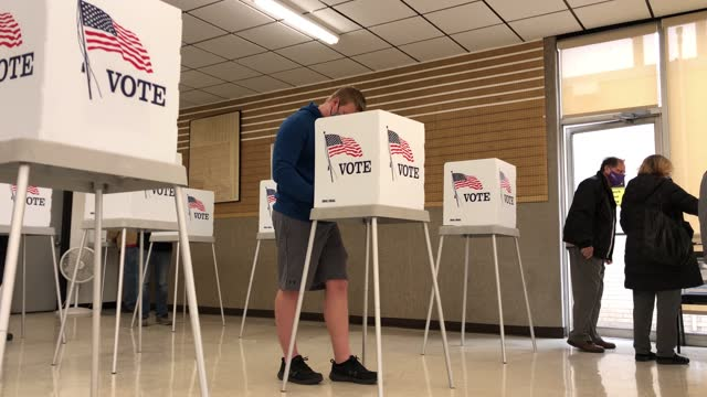 voters participate in early voting in the 2020 presidential election on october 29, 2020 in adel, iowa. voters in the battleground state of iowa are... - election stock videos & royalty-free footage
