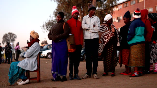 voters queue at a polling station in the mbare district on july 30 2018 in harare zimbabwe zimbabweans are going to the polls to vote for a new... - zimbabwe stock videos & royalty-free footage