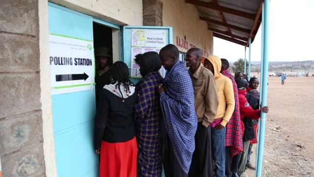 voters queue outside a polling station in kajado, kenya, on tuesday, aug. 8, 2017 - kenya stock videos & royalty-free footage
