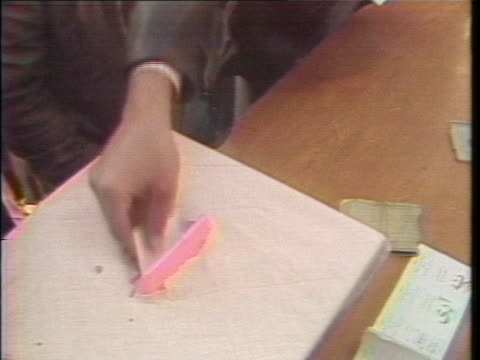 voters submit their ballots in the 1979 iranian presidential election, shortly after the iranian revolution. - 憲法点の映像素材/bロール