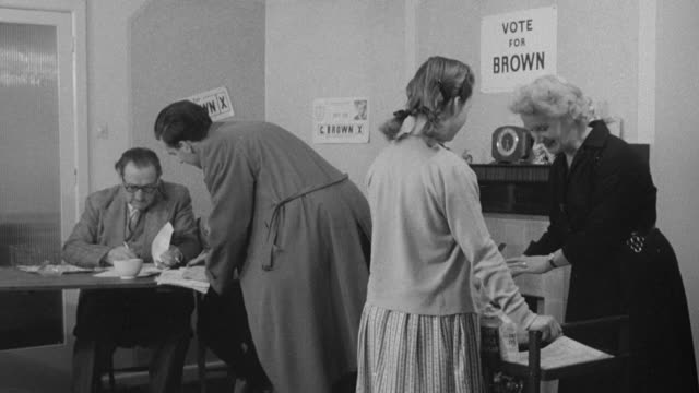 montage voters talking at voting tables and voting / united kingdom - voting ballot stock videos and b-roll footage