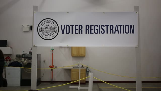 voters turn out to vote at the newmarket fire department in new market, new hampshire on primary day, tuesday, february 9, 2016 photographer: luke... - 2016 video stock e b–roll