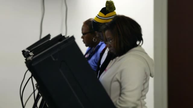 voters use the voting machines to cast their ballots on election day. greensboro, nc. november 4, 2014. - midterm election stock videos & royalty-free footage