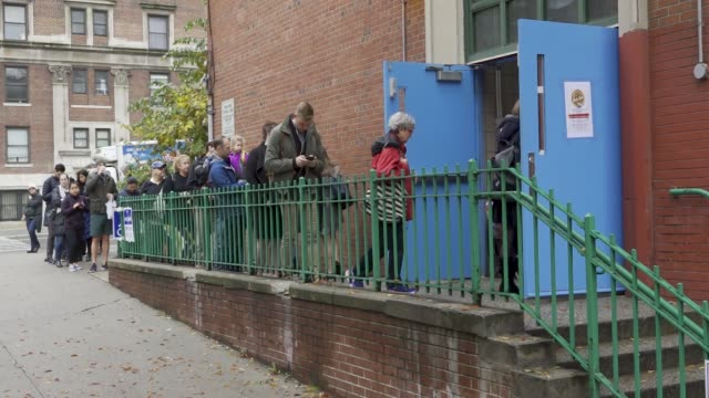 Voters wait during the morning to enter a public school on the Upper West Side of Manhattan in New York City