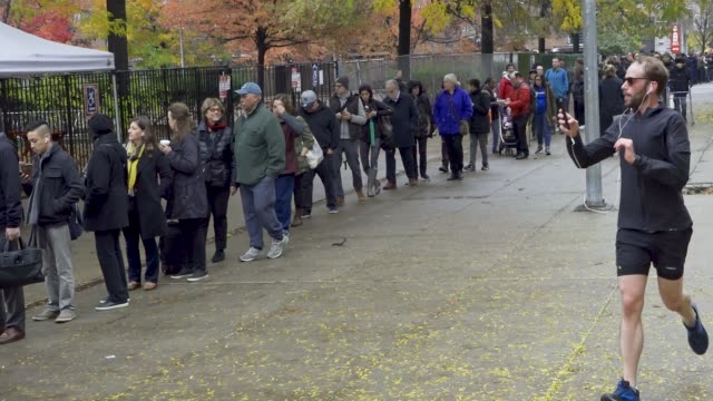 voters wait during the morning to enter a public school on the upper west side of manhattan in new york city - 中間選挙点の映像素材/bロール