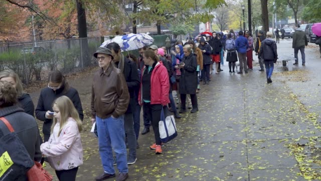 voters wait during the morning to enter a public school on the upper west side of manhattan in new york city - midterm election stock videos & royalty-free footage