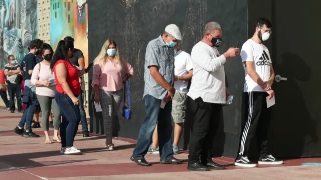 voters wait in line to cast their early ballots at the hialeah john f kennedy library polling station on october 28 2020 in hialeah florida across... - hialeah stock videos & royalty-free footage