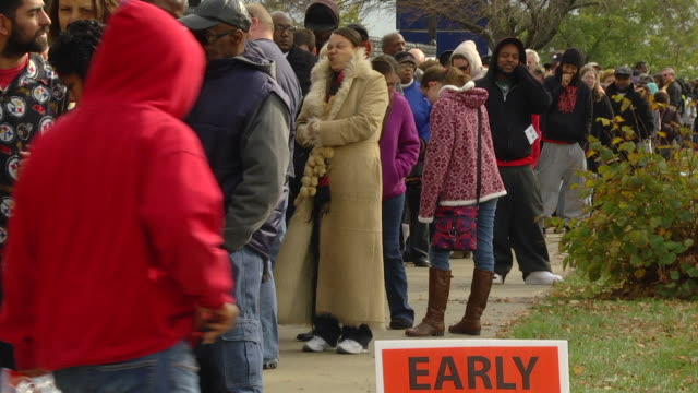 ms zo voters waiting in line to cast their ballots at early voting location two days before presidential election / toledo, ohio, united states - 投票点の映像素材/bロール