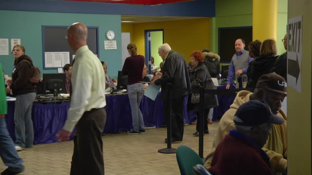 ms voters with completed ballots talk with clerks at early voting location five days before presidential election / toledo, ohio, united states - voting ballot stock videos and b-roll footage