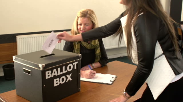 stockvideo's en b-roll-footage met voting in ballot box for the election - stembus