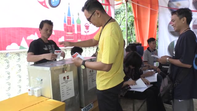voting place being set with world cup 2018 theme to attract voters to participate in indonesian local elections in bogor, west java on june 27, 2018. - international team soccer stock videos & royalty-free footage