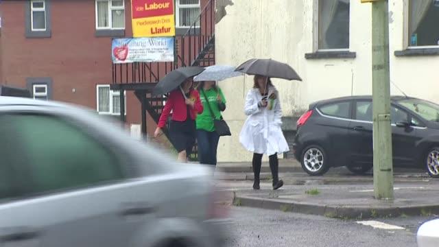 voting plaid cymru leanne wood at polling station wales rhondda ext / raining name 'gorsaf bleidleisio' outside polling station / leanne wood am... - plaid stock videos and b-roll footage
