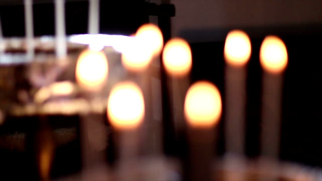 votive candle in a church - votive candle stock videos and b-roll footage