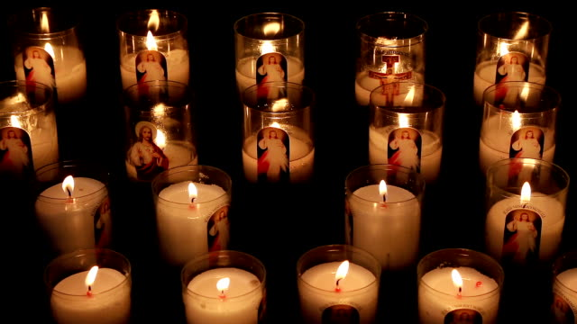 votive candles in the notre dame cathedral, rouen, seine maritime, france - votive candle stock videos and b-roll footage