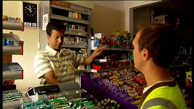 Vox pop Reporter with Amir Haq in convenience store looking at melted ice cream Haq explaining cash till problem to customer Amir Haq interview SOT...
