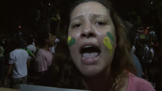 vídeos de stock, filmes e b-roll de vox pop protester who is a schoolteacher says cops only go to the favela where she teaches to shoot and then leave nobody should have to teach in... - carro blindado