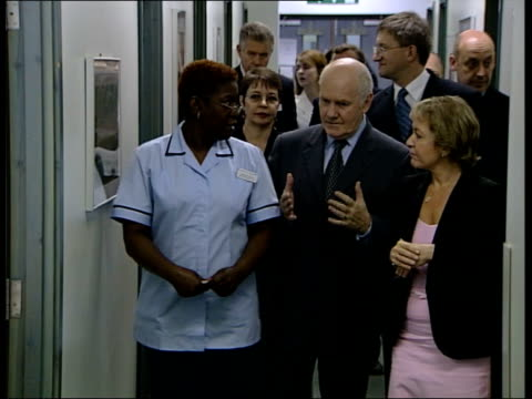 vox pops dental patient dr john reid mp towards along corridor as chatting to nurse and other woman dr john reid mp interviewed sot - i have yes /... - patientin stock-videos und b-roll-filmmaterial