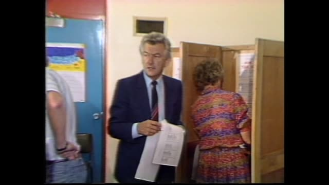 stockvideo's en b-roll-footage met vs opposition leader bob hawke arriving at coburg electoral office to vote accompanied by father clem / vs bob hawke eating cake for his father's... - 1983