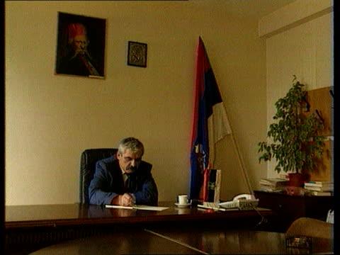 War crimes LIB Former Mayor of Vukovar and alleged war criminal Slavko Dokmanovich working at desk