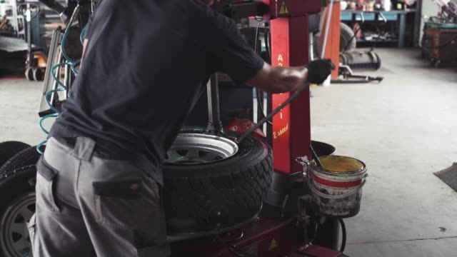 vulcanizer changing the tires - manual worker stock videos and b-roll footage