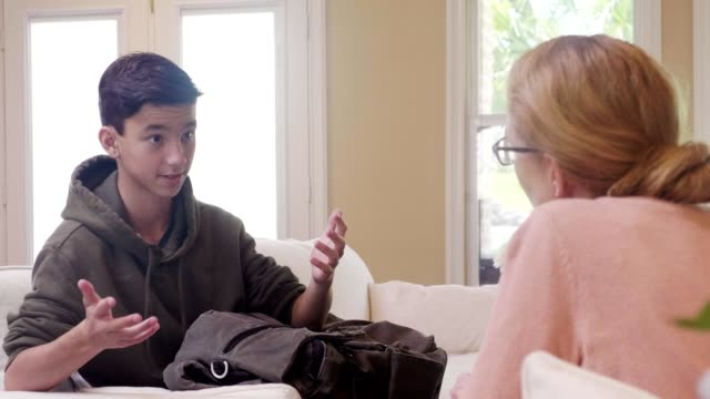 vulnerable boy talks with his mom - parent stock videos & royalty-free footage