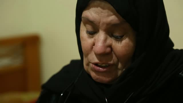 waad al-kateab reflects on 10 years of war in syria; lebanon: beirut: int various of hajjeh fadwa in her room in shatila camp, looking at family... - war and conflict video stock e b–roll