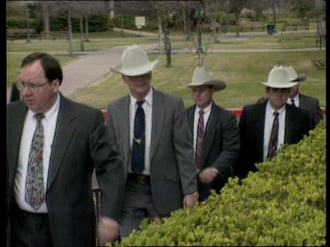 Waco trials Waco trials ITN MS Texan police arriving at court wearing cowboy hats