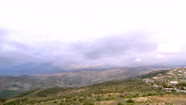 wadi taym zoomin to the cloudcapped foothills of mount hermon and the valleys of wadi taym in southern lebanon - foothills stock videos & royalty-free footage