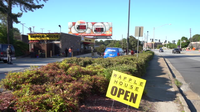 stockvideo's en b-roll-footage met waffle house begins re‐opening restaurants to seated customers while implementing protocols for social distancing as a result of covid19 in... - heropening