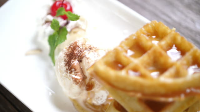 slo mo waffles and cream - waffles stock videos and b-roll footage