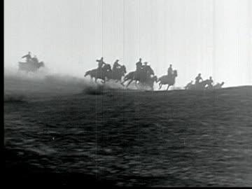 1925 b/w montage ms ws swish pan ha la ts pan wagons and riders racing across plains during land rush in 1889 / santa clarita, california, usa - swish pan stock videos & royalty-free footage