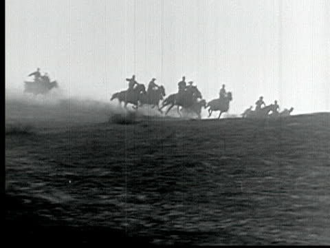 1925 b/w montage ms ws swish pan ha la ts pan wagons and riders racing across plains during land rush in 1889 / santa clarita, california, usa - santa clarita stock videos & royalty-free footage