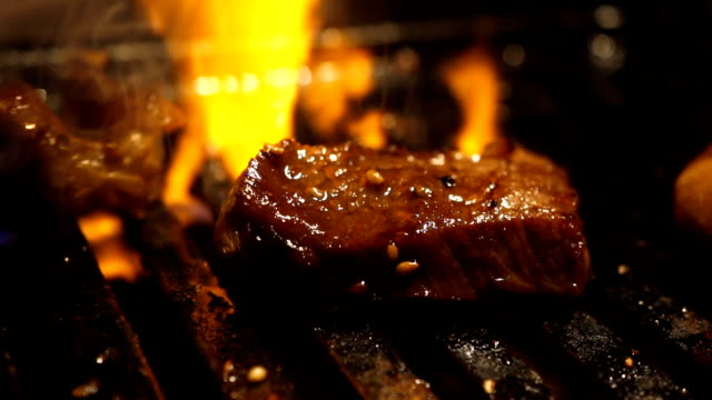 wagyu premium beef grill with flame background. Izakaya japan style meat grill.
