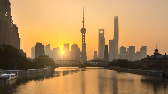 tl waibaidu bridge and pudong skyline at sunrise - shanghai stock videos & royalty-free footage