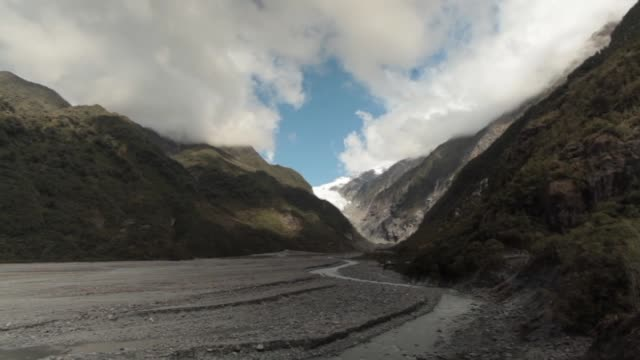 Waiho River at the foot of Franz Josef Glacier in Westland Tai Poutini National Park with water flowing over small rocks