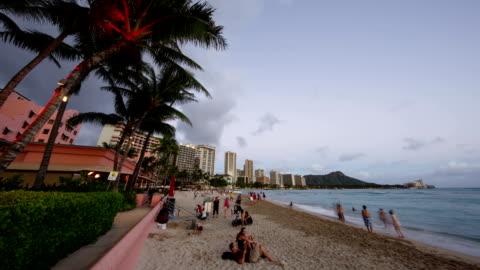 waikiki beach hotel and beach at sunset in honolulu, hawaii, usa - pacific islands stock videos & royalty-free footage