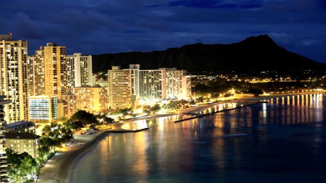 waikiki beach night time lapse - oahu stock videos & royalty-free footage