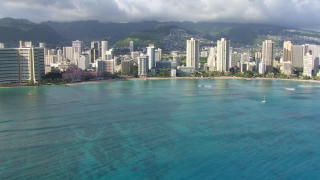ws aerial tu waikiki beach, sea in foreground / hawaii, united states - hawaii islands stock videos and b-roll footage