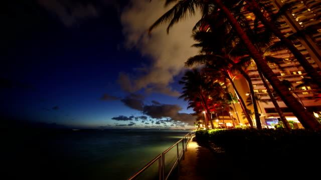 waikiki hotel at night in honolulu, hawaii, usa - honolulu stock videos and b-roll footage
