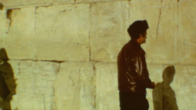 wailing wall directions / western wall plaza / writing notes / placing note in crevice / prayer / wailing wall note on september 03 1974 in jerusalem... - crevice stock videos and b-roll footage