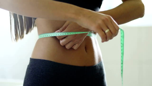 waistline centimetres - dieting stock videos & royalty-free footage