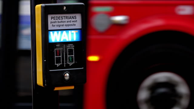 wait sign for pedestrians in london - traffic light stock videos & royalty-free footage