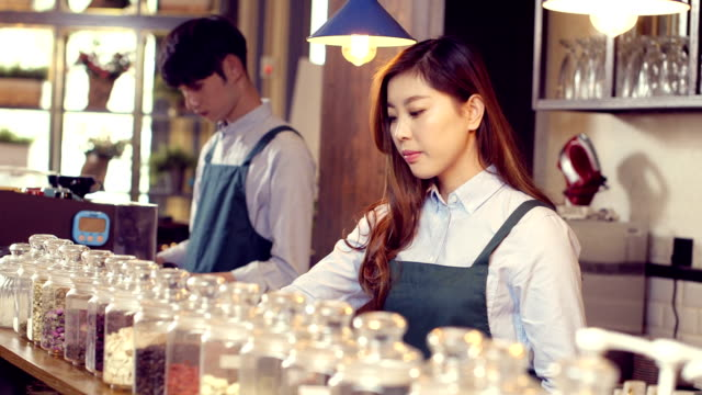 waiter and waitress in modern cafe