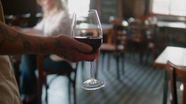 waiter bringing red wine to the customer in argentinian restaurant - southern european stock videos & royalty-free footage
