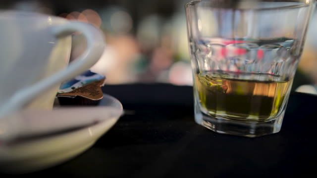 waiter carries whiskey and coffee with milk on tray to serve restaurant guests - carrying stock videos & royalty-free footage