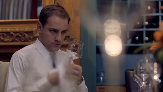 stockvideo's en b-roll-footage met cu waiter cleaning wine glass in restaurant - overhemd en stropdas
