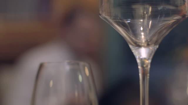 CU Waiter cleaning wine glass in restaurant
