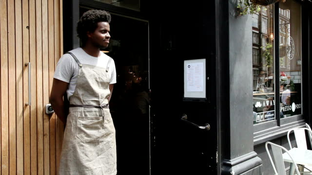 waiter greeting customer - entering stock videos & royalty-free footage