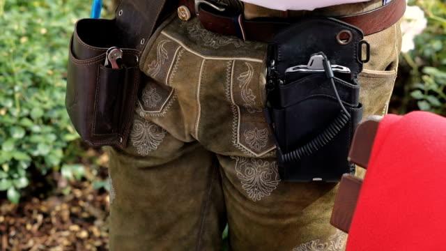 waiter in lederhose,wallet,money,credit card reader - austrian costume stock videos and b-roll footage
